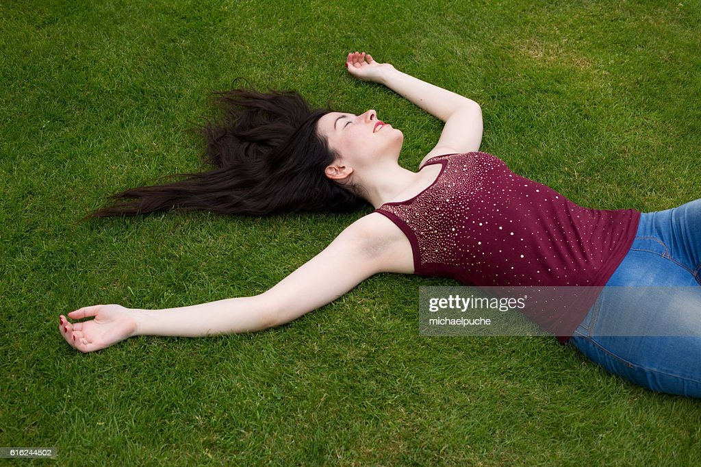 lying in the park : Stock Photo