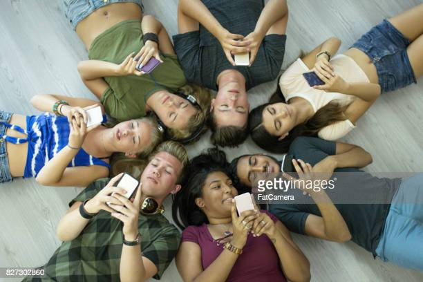 lying on the floor - phone cover stock pictures, royalty-free photos & images