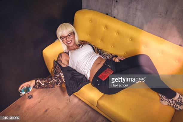 Lying on the sofa at the club