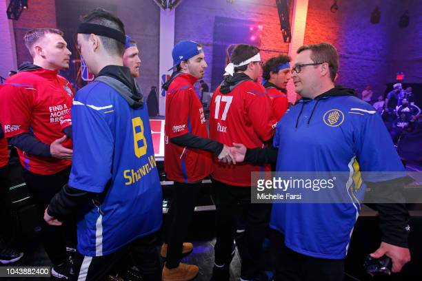 LYKaPRO of Warriors Gaming Squad exchanges handshakes with iiNsaniTTy during the NBA 2K League Mid Season Tournament on June 8 2018 at the NBA 2K...