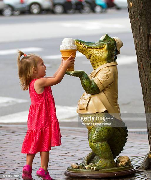 Lyla Rose of Windham reaches for a sculpted ice cream cone Sunday on Commercial Street