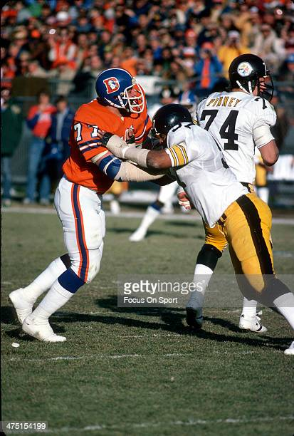 Lyle Alzado of the Denver Broncos in action against Sam Davis of the Pittsburgh Steelers during an NFL Football game December 16 1978 at Mile High...