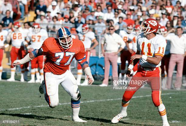 Lyle Alzado of the Denver Broncos puts pressure on Tony Adams of the Kansas City Chiefs during an NFL Football game December 10 1978 at Mile High...