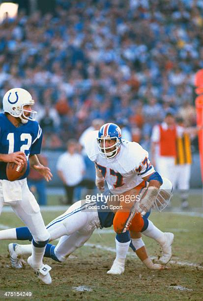 Lyle Alzado of the Denver Broncos puts the pressure on Bill Troup of the Baltimore Colts during an NFL Football game October 22 1978 at Memorial...