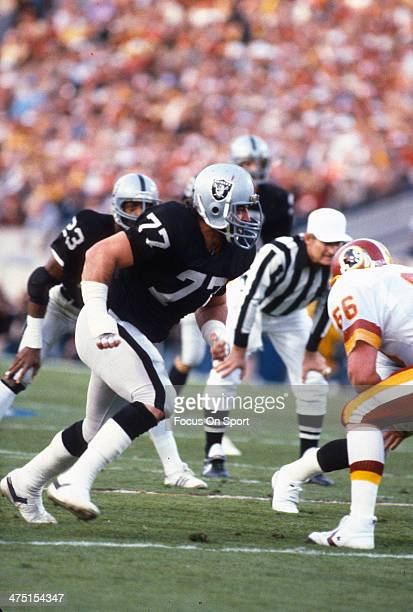 Lyle Alzado of the Los Angeles Raiders in action against the Washington Redskins October 2 1983 during an NFL football game at RFK Stadium in...