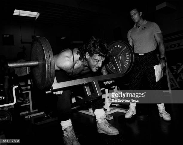 Lyle Alzado of the Los Angeles Raiders lifts weights circa 1980s