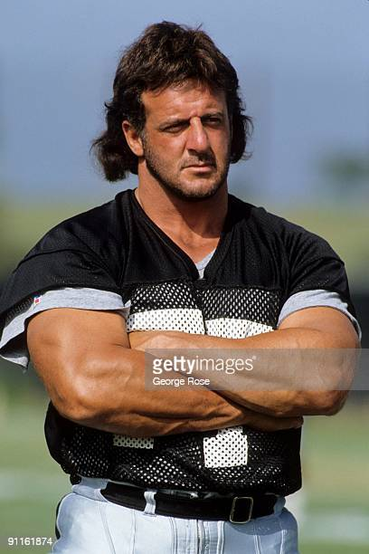 Lyle Alzado of the Los Angeles Raiders looks on during August of 1990 training camp in Oxnard California