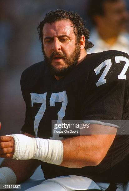 Lyle Alzado of the Los Angeles Raiders looks on from the bench during an NFL Football game circa 1983 at the Los Angeles Memorial Coliseum in Los...