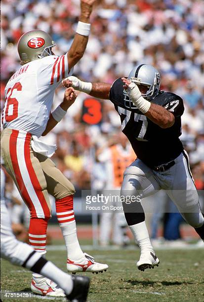 Lyle Alzado of the Los Angeles Raiders puts pressure on Joe Montana of the San Francisco 49ers during an NFL Football game September 22 1985 at the...