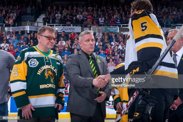 Lyle Brons and Kevin Garinger president of the Humboldt Broncos stand at centre ice for the ceremonial puck drop between Regina Pats and Hamilton...
