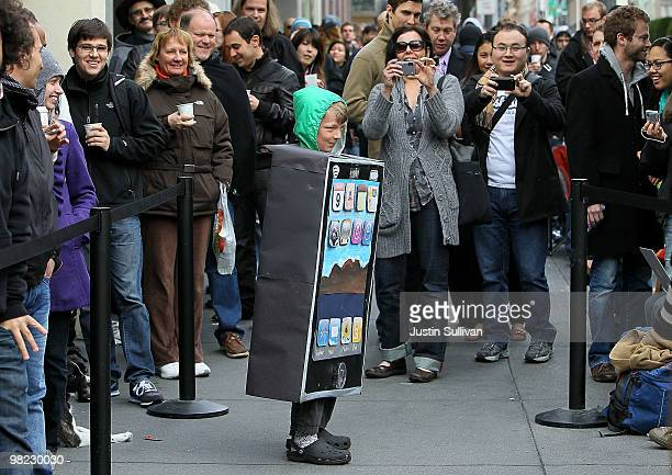 Lyle Haney stops to have his picture taken as he wears a iPad costume while waiting in line to purchase the new iPad at an Apple store April 3 2010...