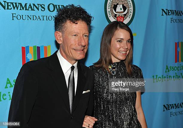 Lyle Lovett and April Kimble attend the celebration of Paul Newman's Hole in the Wall Camps at Avery Fisher Hall Lincoln Center on October 21 2010 in...