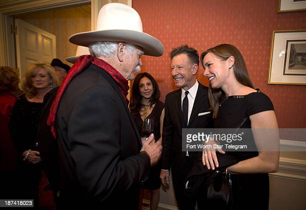 Lyle Lovett and April Kimble right meet Stephen Murrin Jr before walking the red carpet before being honored with the Stephen Bruton Award at the...