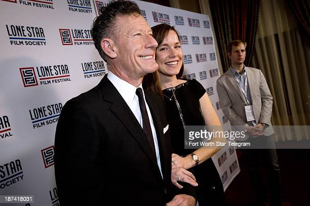 Lyle Lovett and April Kimble walk the red carpet before he received the Stephen Bruton Award at the 2013 Lone Star Film Festival Ball in Fort Worth...