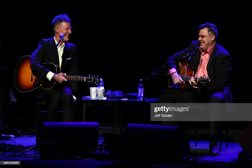 Lyle Lovett (L) and Vince Gill share a laugh as they perform in support of their 'Songs and Stories Tour' at Fred Kavli Theatre on March 22, 2017 in Thousand Oaks, California.
