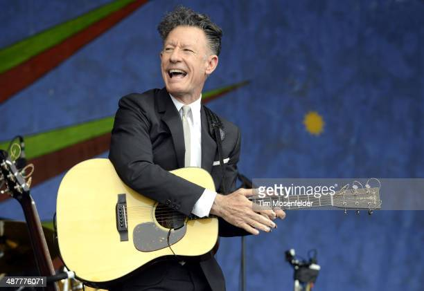 Lyle Lovett performs during Day 4 of the 2014 New Orleans Jazz Heritage Festival at Fair Grounds Race Course on May 1 2014 in New Orleans Louisiana