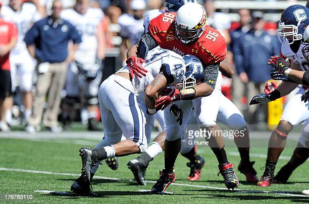 Lyle McCombs of the Connecticut Huskies is tackled by AJ Francis of the Maryland Terrapins at Byrd Stadium on September 15 2012 in College Park...