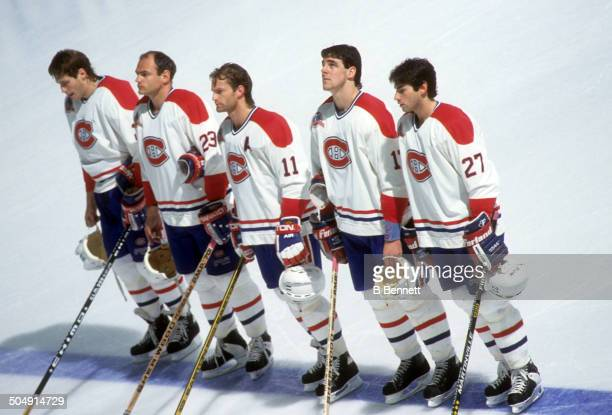Lyle Odelein Brian Bellows Kirk Muller John LeClair and Mathieu Schneider of the Montreal Canadiens stand on the blue line during the national anthem...