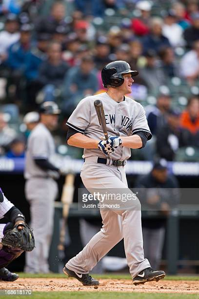 Lyle Overbay of the New York Yankees bats against the Colorado Rockies at Coors Field on May 9 2013 in Denver Colorado The Yankees defeated the...