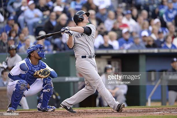 Lyle Overbay of the New York Yankees bats against the Kansas City Royals on May 11 2013 at Kauffman Stadium in Kansas City Missouri The New York...