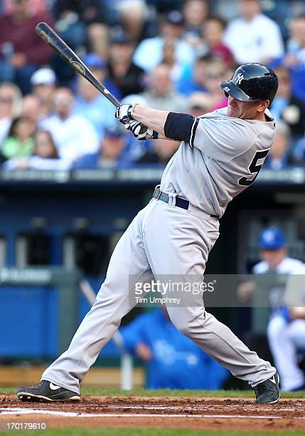 Lyle Overbay of the New York Yankees bats in a game against the Kansas City Royals at Kauffman Stadium on May 11 2013 in Kansas City Missouri The...