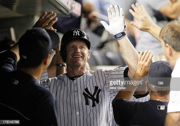Lyle Overbay of the New York Yankees celebrates in the dugout after hitting a grandslam in the sixth inning against the Kansas City Royals at Yankee...
