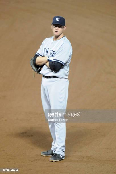 Lyle Overbay of the New York Yankees looks on during a baseball game against the Baltimore Orioles on May 20 2013 at Oriole Park at Camden Yards in...