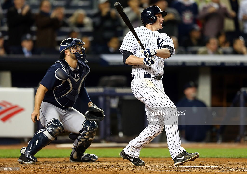 Lyle Overbay #55 of the New York Yankees watches his SAC fly to score the game winning run as Kelly Shoppach #7 of the Seattle Mariners defends on May 14, 2013 at Yankee Stadium in the Bronx borough of New York City.