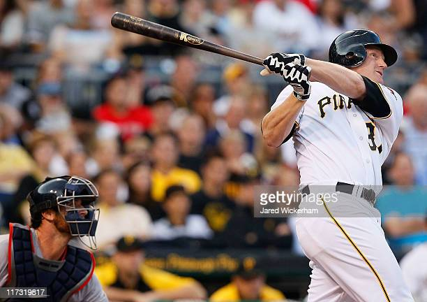Lyle Overbay of the Pittsburgh Pirates hits a three run home run in the fourth inning against the Boston Red Sox during the game on June 25 2011 at...