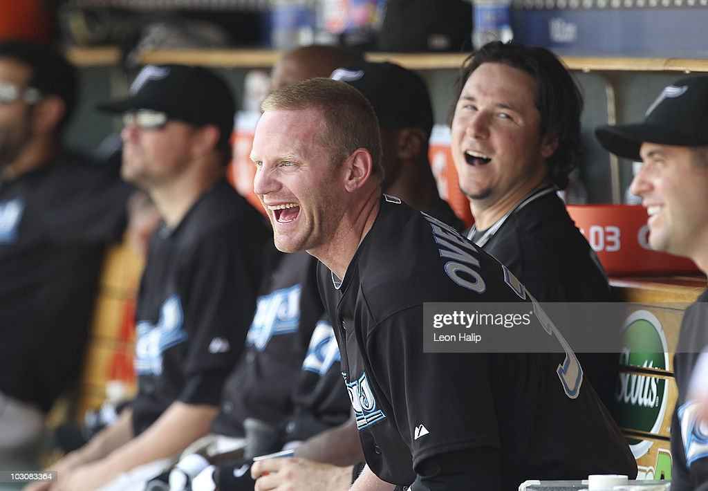 Lyle Overbay #35 of the Toronto Blue Jays shares a laught in the dugout after hitting the game winning home run in the ninth inning against the Detroit Tigers on July 25, 2010 at Comerica Park in Detroit, Michigan. The Blue Jays defeated the Tigers 5-3.