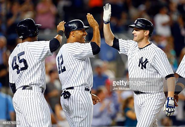 Lyle Overbay Vernon Wells and Zoilo Almonte of the New York Yankees in action against the Kansas City Royals at Yankee Stadium on July 10 2013 in the...