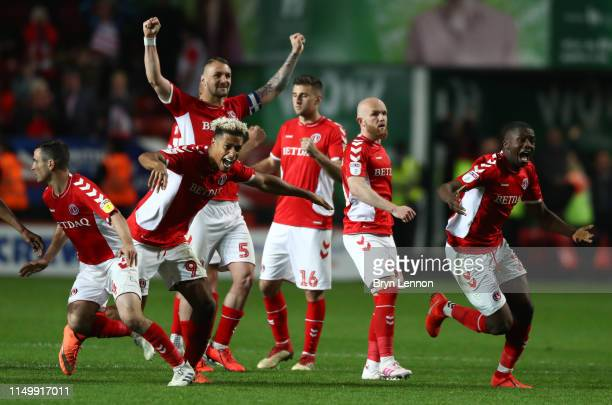 Lyle Taylor and Anfernee Dijksteel of Charlton Athletic celebrate victory in the penalty shoot out with team mates after the Sky Bet League One...