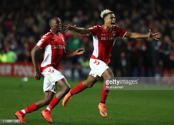 Lyle Taylor and Joe Aribo of Charlton Athletic celebrate victory in the penalty shoot out after the Sky Bet League One PlayOff Second Leg match...