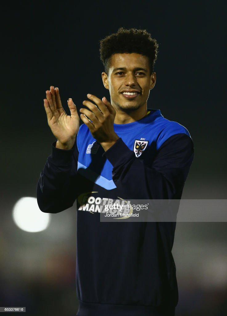 Lyle Taylor of A.F.C. Wimbledon acknowledges the crowd at the end of the Sky Bet League One match between A.F.C. Wimbledon and Milton Keynes Dons at The Cherry Red Records Stadium on March 14, 2017 in Kingston upon Thames, England.