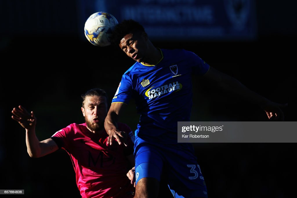 Lyle Taylor (R) of A.F.C. Wimbledon and Ben Coker (L) of Southend United challenge for the ball during the Sky Bet League One match between A.F.C. Wimbledon v Southend United at the Cherry Red Records Stadium on March 25, 2017 in Kingston upon Thames, United Kingdom.