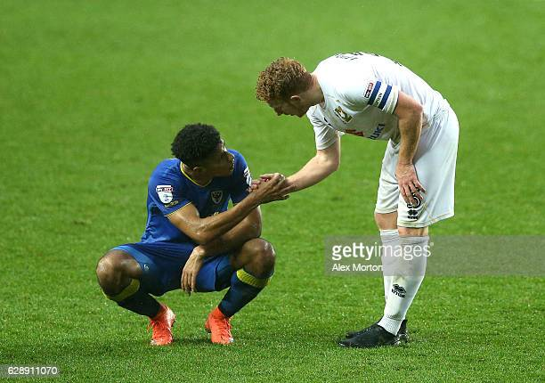 Lyle Taylor of AFC Wimbledon and Dean Lewington of MK Dons shake hands after the final whistle during the Sky Bet League One match between Milton...