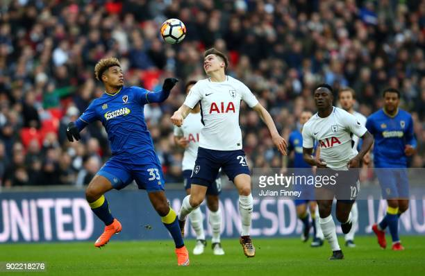 Lyle Taylor of AFC Wimbledon and Juan Foyth of Tottenham Hotspur battle for the ball during The Emirates FA Cup Third Round match between Tottenham...