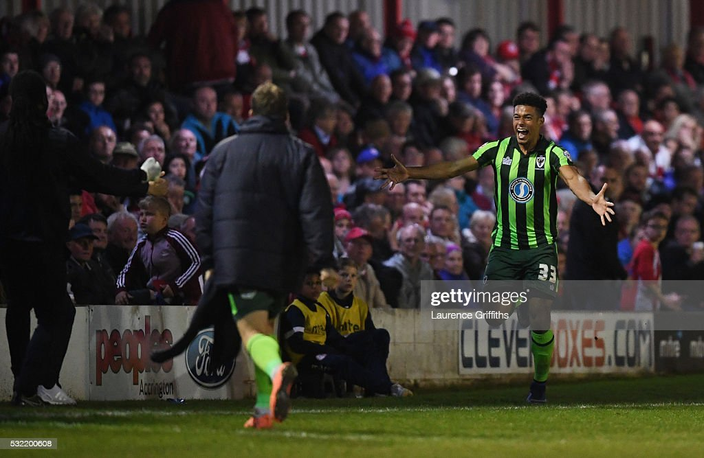 Lyle Taylor #33 of AFC Wimbledon celebrates after scoring a goal in the first period of extra time to give his team a 3-2 aggregate lead during the Sky Bet League Two play off, Second Leg match between Accrington Stanley and AFC Wimbledon at The Crown Ground on May 18, 2016 in Accrington, England.