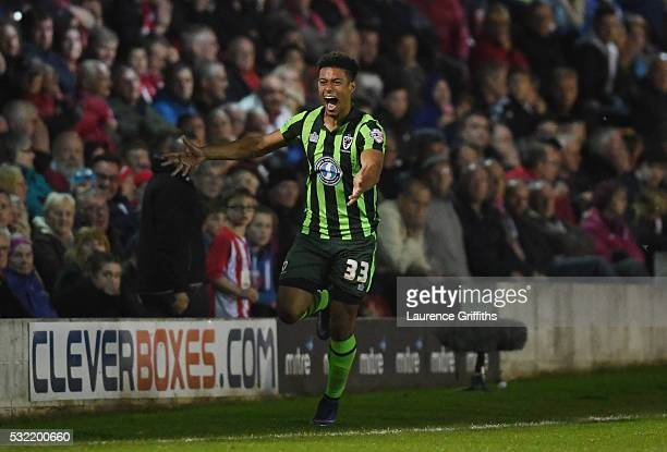 Lyle Taylor of AFC Wimbledon celebrates after scoring a goal in the first period of extra time to give his team a 32 aggregate lead during the Sky...
