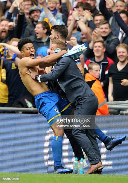 Lyle Taylor of AFC Wimbledon celebrates after scoring a goal to make it 10 with Neal Ardley the head coach / manager of AFC Wimbledon during the Sky...