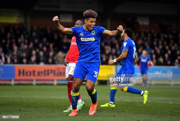 Lyle Taylor of AFC Wimbledon celebrates after scoring his sides second goal during the The Emirates FA Cup Second Round match between AFC Wimbledon...