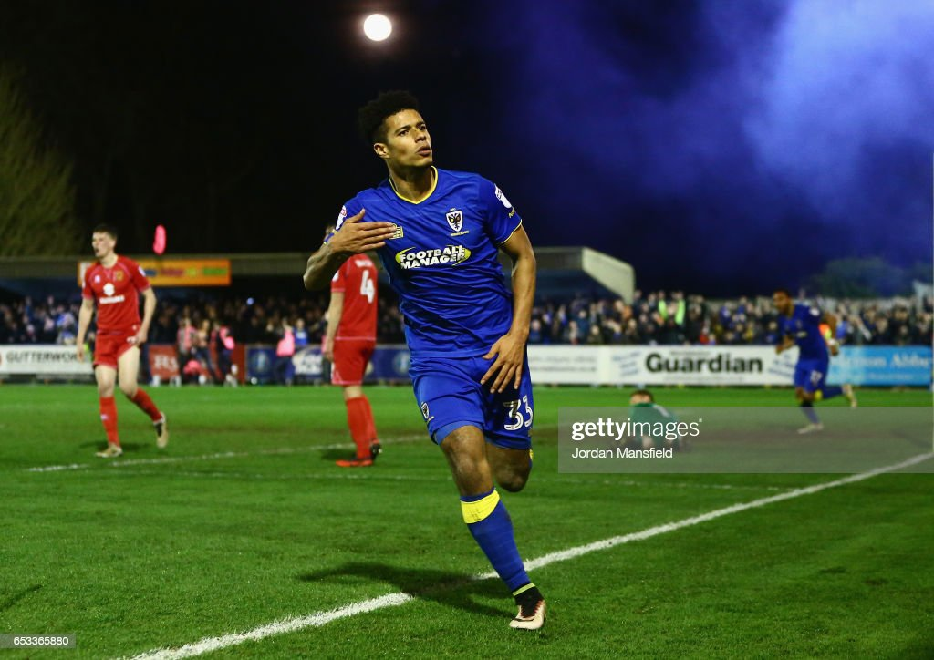 Lyle Taylor of A.F.C. Wimbledon celebrates after scoring the second goal during the Sky Bet League One match between A.F.C. Wimbledon and Milton Keynes Dons at The Cherry Red Records Stadium on March 14, 2017 in Kingston upon Thames, England.