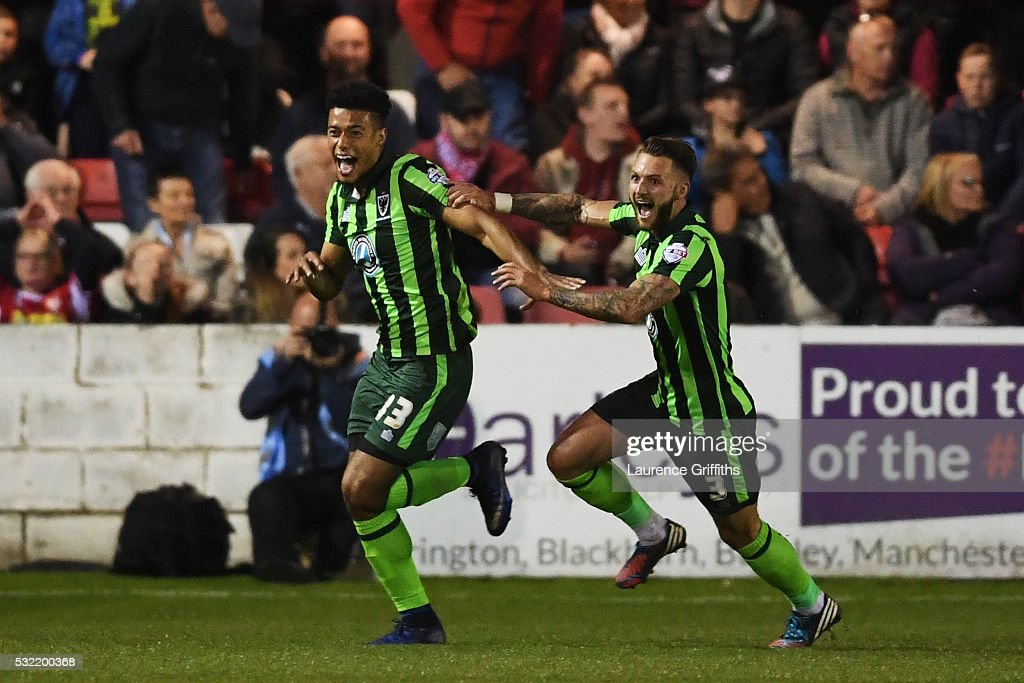 Lyle Taylor #33 of AFC Wimbledon celebrates with teammate Callum Kennedy after scoring a goal in the first period of extra time to give his team a 3-2 aggregate lead during the Sky Bet League Two play off, Second Leg match between Accrington Stanley and AFC Wimbledon at The Crown Ground on May 18, 2016 in Accrington, England.