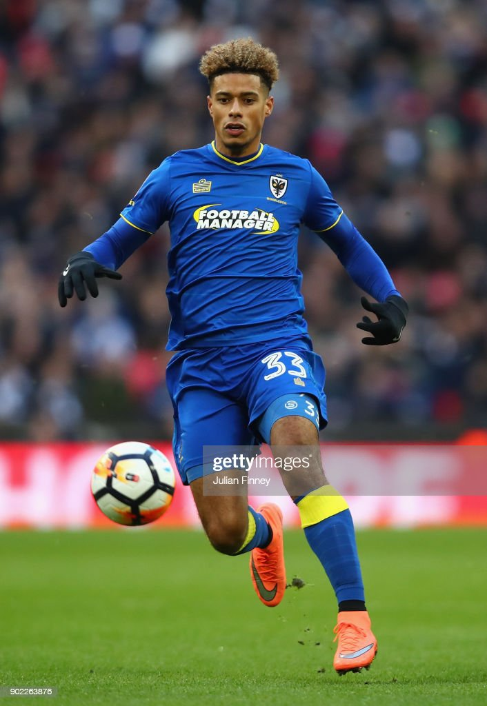 Lyle Taylor of AFC Wimbledon in action during The Emirates FA Cup Third Round match between Tottenham Hotspur and AFC Wimbledon at Wembley Stadium on January 7, 2018 in London, England.