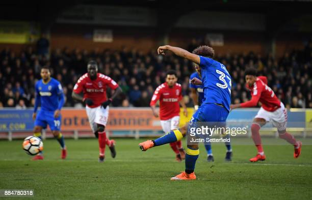 Lyle Taylor of AFC Wimbledon scores his sides third goal during the The Emirates FA Cup Second Round match between AFC Wimbledon Charlton Athletic at...