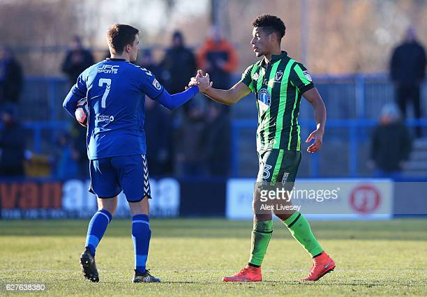 Lyle Taylor of AFC Wimbledon shakes hands with hat trick scorer Adam Morgan of Curzon Ashton after the Emirates FA Cup second round match between...