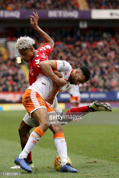 Lyle Taylor of Charlton Athletic challenges for the ball with Curtis Tilt of Blackpool during the Sky Bet League One match between Charlton Athletic...