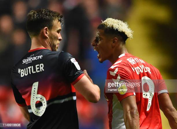 Lyle Taylor of Charlton Athletic reacts towards Andy Butler of Doncaster Rovers during the Sky Bet League One PlayOff Second Leg match between...