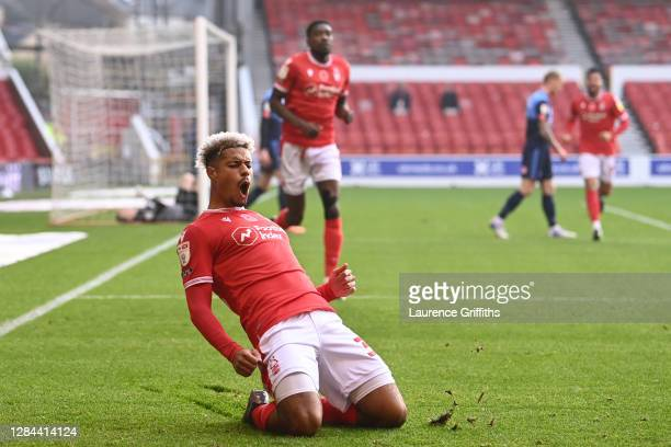 Lyle Taylor of Nottingham Forest celebrates after scoring his team's first goal during the Sky Bet Championship match between Nottingham Forest and...