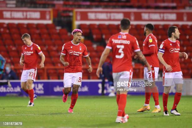Lyle Taylor of Nottingham Forest celebrates with teammates after scoring his team's first goal during the Sky Bet Championship match between...
